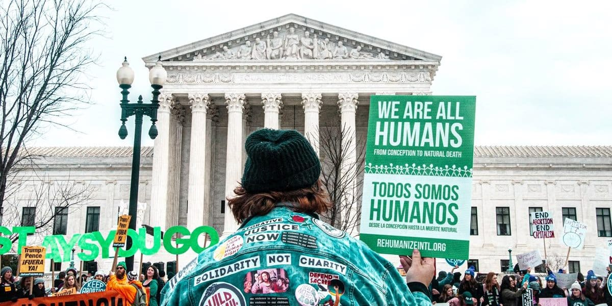 activists in front of the Supreme Court