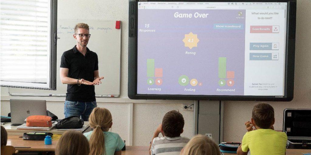 A male teacher in a classroom