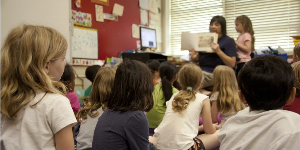 a teacher and her students in a classroom.